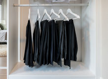 Row of pants hanging on coat hanger Royalty Free Stock Photography