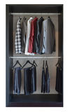 Row of pants and shirts hanging in wooden wardrobe Royalty Free Stock Photo