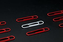 Row of paper clip on black background. Different concept Royalty Free Stock Photography