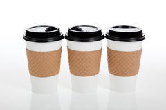 Row of paper coffee cups on white Stock Images