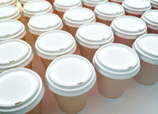 A row of paper coffee cups. Royalty Free Stock Image