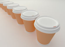 A row of paper coffee cups. Royalty Free Stock Images