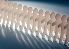 Row of paper cut figures Royalty Free Stock Photography
