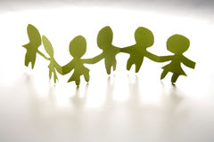 Row of paper dolls. A row of paper dolls on a white background Royalty Free Stock Photography