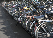 Row of parked bicycles Royalty Free Stock Images