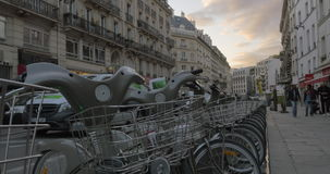 Row of parked bicycles in Paris street. PARIS, FRANCE - SEPTEMBER 06, 2015: A lot of bicycles with baskets parked in a row along the street. Bike is a popular stock video