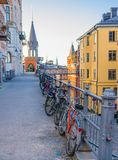 Row of parked Bikes, bicycles near railing, Stockholm, Sweden royalty free stock photos