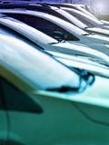 Row of parked cars in a receding line Royalty Free Stock Image