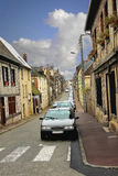 Row of parked cars on the street of Verneuil-sur-Avre. Stock Photography