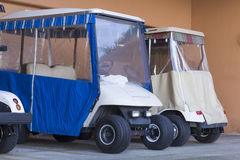 A row of parked golf carts. Golf carts parked in a garage in Florida Stock Image