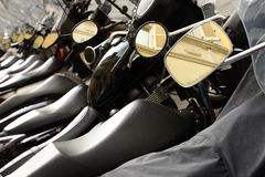 Row of parked motorcycles Stock Image