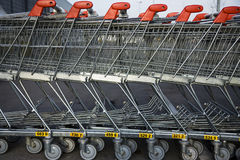 Row of parked trolleys. The hypermarket Stock Images