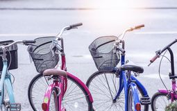Row of parked vintage bicycles. With sunlight Stock Image