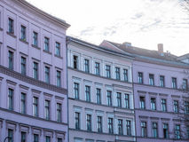 Row of Pastel Colored Low Rise Urban Buildings. Architectural Exterior Detail of Urban Low Rise Buildings in Cool Tone Pastel Colors Backlit by Bright Early or Stock Photography