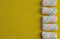 A row of pastel colored marshmallows Stock Photography