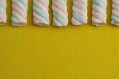 A row of pastel colored marshmallows Stock Photo