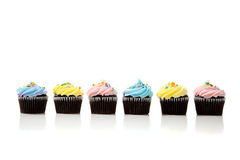 A row of pastel cupcakes on a white background Stock Photography