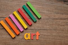 A row of pastels with the word art. On a wooden background stock photo