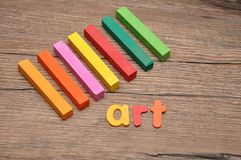A row of pastels with the word art. On a wooden background royalty free stock photos