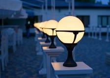 Row of Patio Lights Illuminating Soft Light Stock Photography