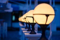 Row of Patio Lights Illuminating Soft Light Royalty Free Stock Photography
