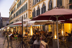 Row of Pavement Cafes in Malaga on January Evening Stock Photography