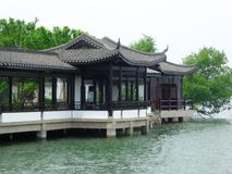 A row pavilion near a lake. A row ancient pavilions for tourists to rest near a lake in liyang city jiangsu province China stock image