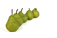 Row of pears. Row of five green pears Royalty Free Stock Photos