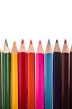 Row of pencil colors on a white backgroiund. Pencil colors on a white backgroiund royalty free stock photos