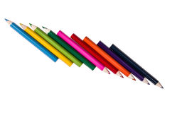 Row of pencil colors on a white backgroiund. Pencil colors on a white backgroiund royalty free stock images