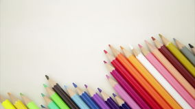 Row of pencil crayons stock footage