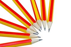 Row of pencil red and yellow alternating isolated on white background. Close up row of pencil red and yellow alternating isolated on white background stock photos