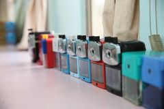 Row of pencil sharpeners. A row of pencil sharpeners in a classroom Stock Photography