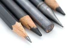 Row of Pencils. A photo of a row of pencils over a white background Stock Photos