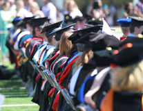 Row of people at graduation, Northwestern Oklahoma State University. May 6, 2017, graduation commencement on the football field in Alva, Oklahoma. A row of Stock Image