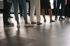 Row of people in queue. Queue is the good thing that can reflected a regulation of people royalty free stock photo
