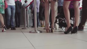 Row of people waiting in an airport. Feet of people in line at the airport.  stock video