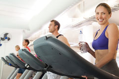 Row of people working out on treadmills Royalty Free Stock Photos