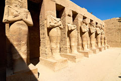 Row of Pharaoh statues in Karnak temple. Linear perspective of Pharaoh statues in Karnak temple, Egypt Stock Photo
