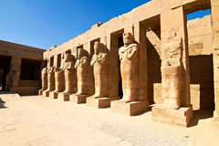 Row of Pharaoh statues in linear perspective. Row of Pharaoh statues in ancient Karnak temple, Egypt Royalty Free Stock Photography