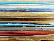 A row of piled up records stock image