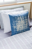 Row of pillows in modern single bedroom Royalty Free Stock Images