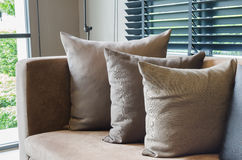 Row of pillows on modern sofa Royalty Free Stock Image