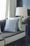 Row of pillows on modern sofa in living room Royalty Free Stock Image