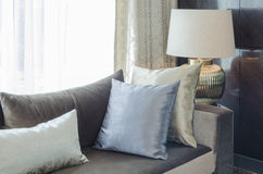 Row of pillows on modern sofa in living room Stock Images