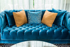 Row of pillows on sofa in living room Stock Photo