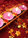 Row of pink candles with stars Stock Photo