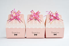 A row of  gift boxes. A row of pink gift boxes with pink flowers Royalty Free Stock Image