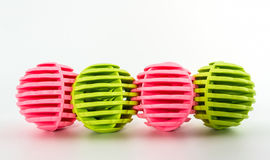 Row of Pink and green washing ball, plastic balls Stock Photo