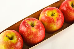Row of pink lady apples Stock Photo